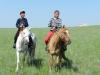 Участники конных скачек. Празднование 20-летия российско-монгольско-китайского международного заповедника «Даурия», 24-28 июня 2014 г., Восточная Монголия. Фото Т. Горошко